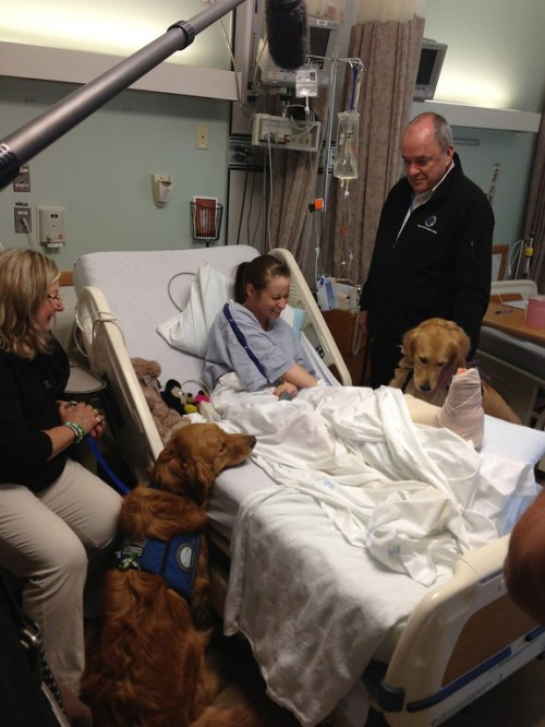 Luther and Ruthie visit with a survivor before surgery for a leg injury (courtesy Lutheran Church Charities)