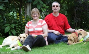 Claire Johnson and Mark Gaffey  with their guide dogs, Venice and Rodd.  copyright Dave Evitts