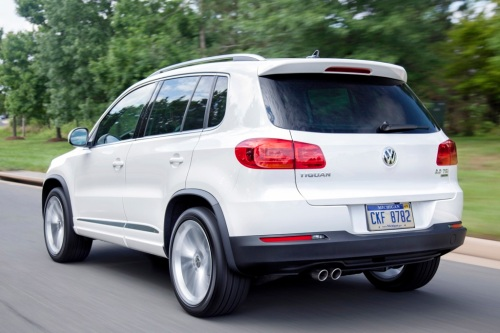 """The Volkswagen Tiguan - """"got its name by combining the words tiger and iguana, so the car's sure to be pet-friendly. The Tiguan is a lot like the Nissan Juke: compact on the outside but deceivingly spacious within. The rear seats fold flat, making room for pets of almost any size, and an optional dog barrier keeps your pet safely contained where it can't distract you.'"""