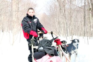 A young cancer patient on the dog sled Credit: Emmanuelle Compte