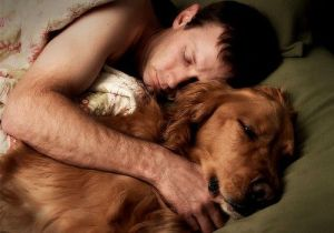 Dog and man sleeping together
