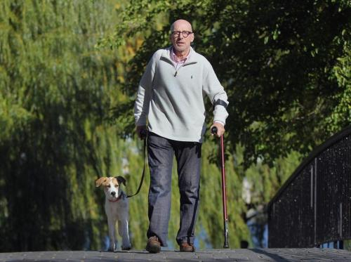 Jeff Schwartz and Mandy on an outing. After his devastating accident, Schwartz rescued a dog and his own way of living. (Photo credit: Wendy Maeda/Globe Staff)