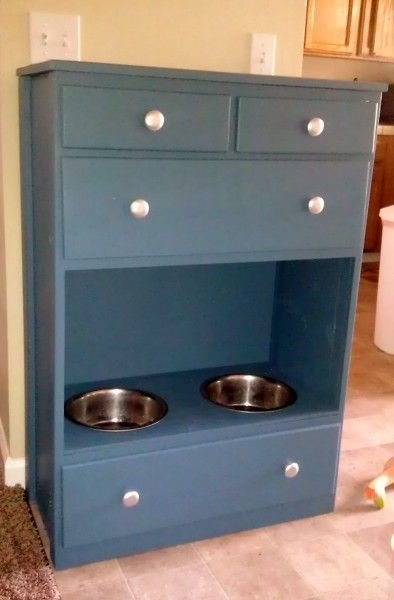 Raised dog bowls in chest of drawers